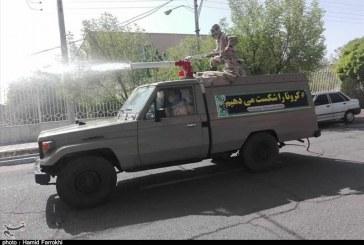 ضدعفونی معابر شهری اردستان توسط نیروی زمینی سپاه به روایت تصویر